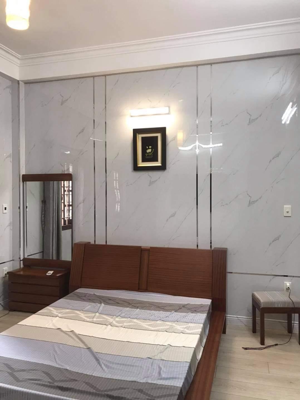 tấm ốp tường phòng ngủ iVn